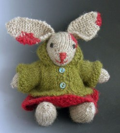 A portrait of Miz Bunn. Photograph by artist of knitted form.