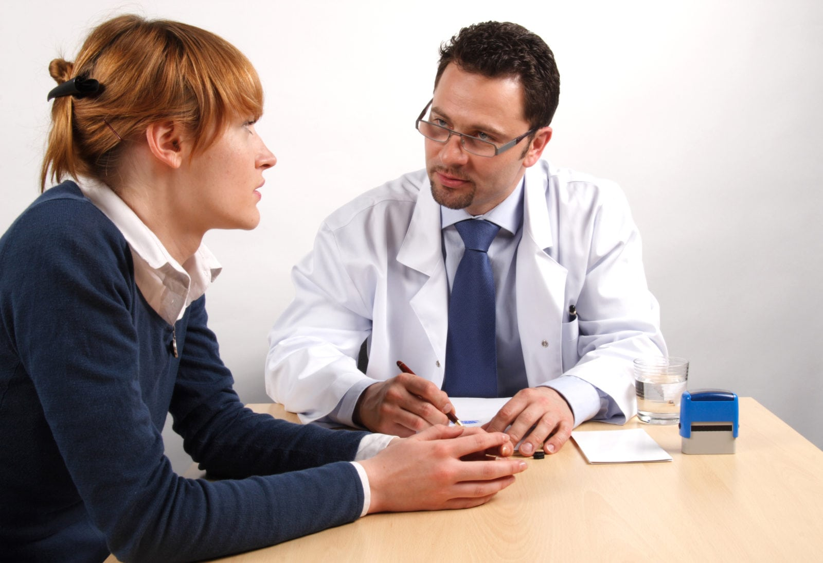 Patient speaking to a doctor about the Early Signs and Symptoms of Cancer