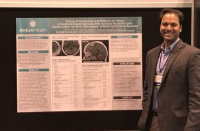 Roshan Prabhu, MD Pictured in from of one of his studies at Atrium Health