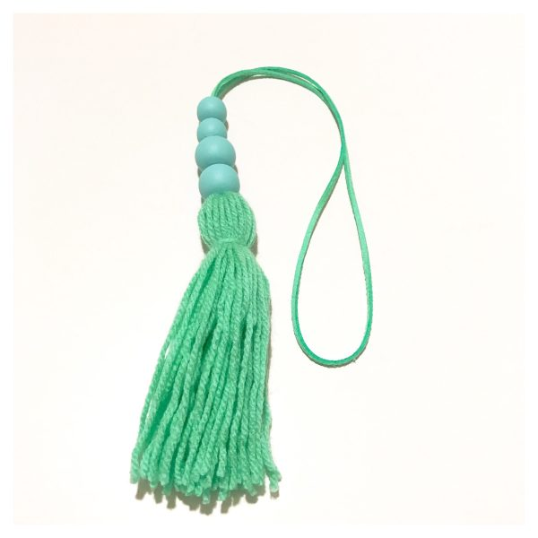 Green tassel wall hangings