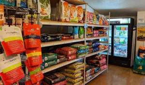 Dog food aisle, both bagged and refrigerated at Tre Bone.