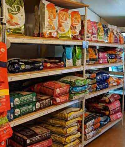 Dog food aisle, both bagged and refrigerated at Tre Bone.