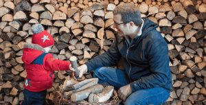 Chopping logs for winter