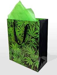 FTP RECEIVE A GIFT BAG INCLUDES THICK GLASS PIPE, ROLLING PAPERS, EDIBLE, LIGHTER, 1 GRAM TOP SHELF FLOWER
