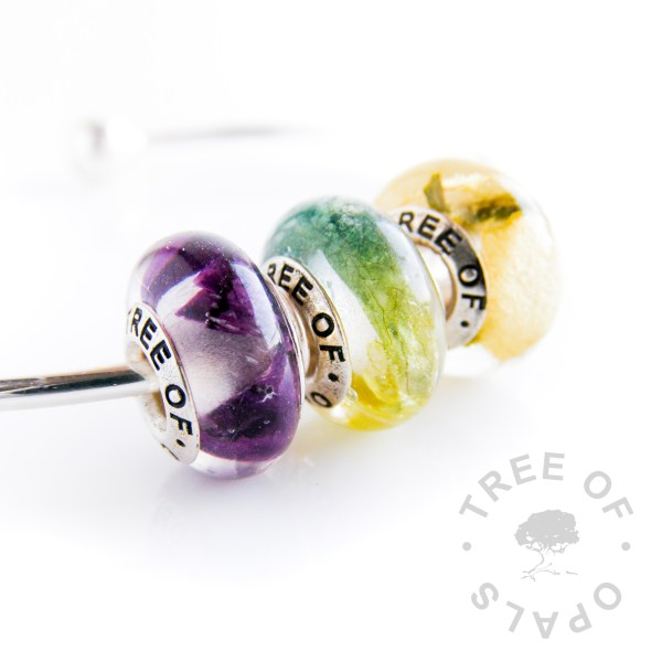 charm bead trio with client's own flowers in crystal clear resin