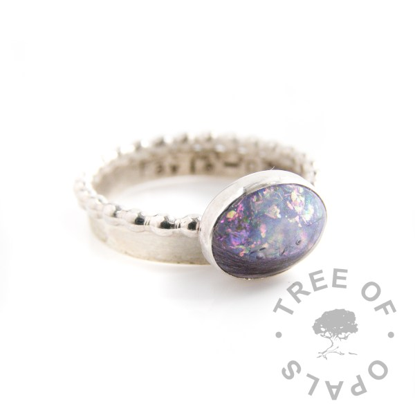 pro bono baby loss lock of hair ring and pink/green opalescent flakes on bubble wire band, plus brushed stamped 3mm band