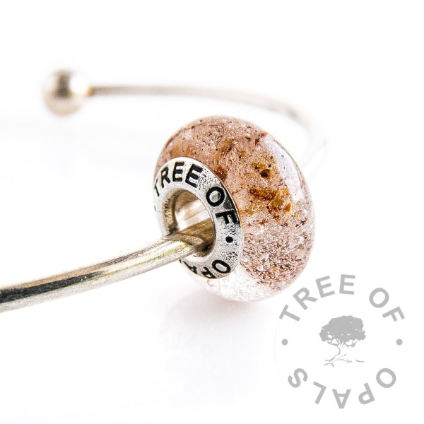 placenta umbilical cord charm bead with crystal clear resin and Tree of Opals signature charm core