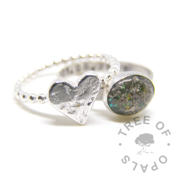 cremation ash ring and stacking ring with an organic textured heart on bubble wire band, cremation ashes and basilisk green sparkle mix on a brushed band engraved with text on the inside. By Tree of Opals memorial jewellery ashes ring