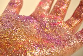 glitter on hand microplastics