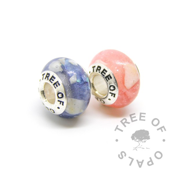 tooth charms with Aegean blue and fairy pink, teeth are turned into large flecks and embedded in resin with Tree of Opals cores