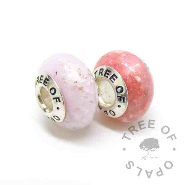 The pros and cons of glass or resin cremation ash jewellery. Glass Ash Charm Sets pink glass cremation charm and fairy pink cremation ash charm resin. Resin or glass jewellery?