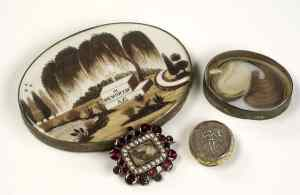 Mourning brooches containing the hair of a deceased relative. Victorian lock of hair jewellery