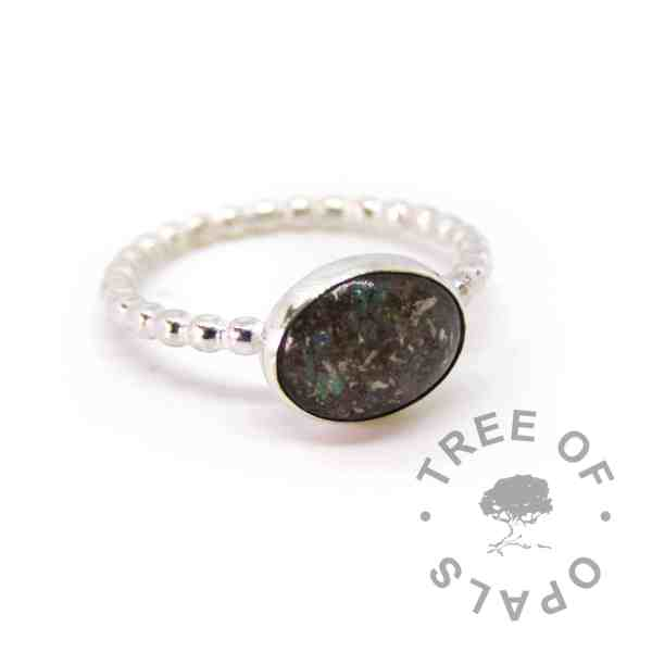 cremation ash ring bubble band, unicorn white sparkles and naturally very dark ashes. Handmade memorial ring with cremains in resin. 10x8mm bezel cup