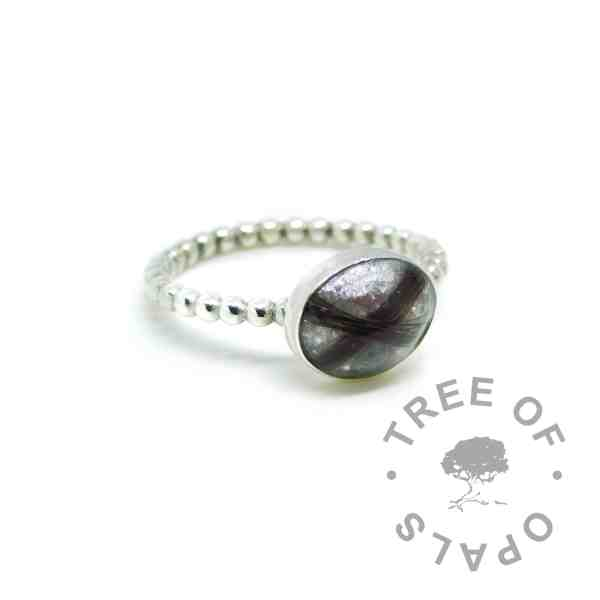 hair ring birthstones, two locks of hair and two birthstones unicorn white resin sparkle mix on bubble wire band. Handmade solid sterling silver memorial jewellery by Tree of Opals