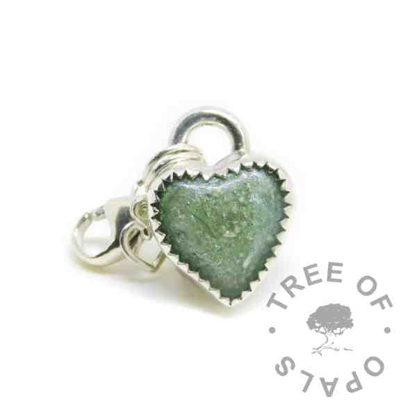 cremation ash heart dangle characm with basilisk green resin sparkle mix. Solid sterling silver handmade setting with lobster clasp dangle setting for Thomas Sabo style necklaces and bracelets