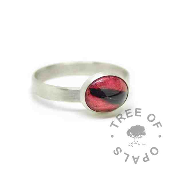 Dragon's blood red lock of hair ring on brushed wire band. Solid sterling EcoSilver handmade ring. 10x8mm bezel cup rubbed over the cabochon for security.