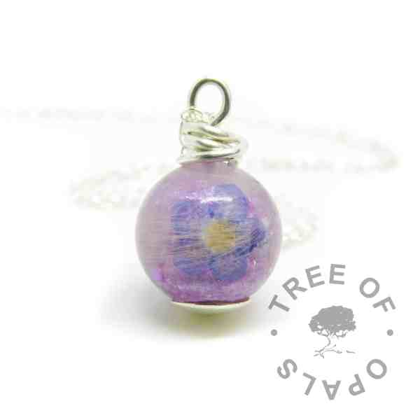 forget-me-not memorial jewellery lock of hair pearl with naturally grey white hair, orchid purple resin sparkle mix in an 11mm sphere. Flat base, solid sterling silver wire wrapped by hand shown with matinee length lightweight chain