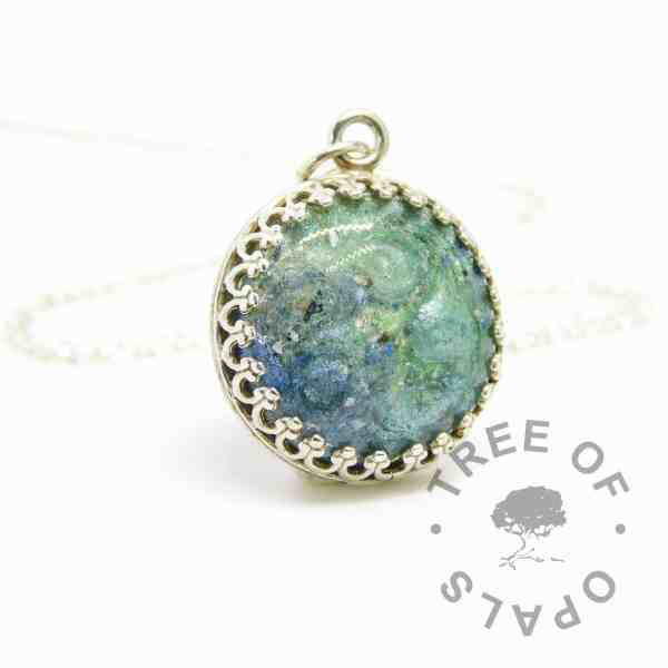 teal ash mystery piece, 16mm crown point necklace with mermaid teal, basilisk green and Aegean blue sparkle mix and cremation ashes