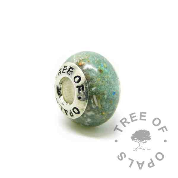 Cremation ash charm with basilisk green resin sparkle mix, no birthstone, gold leaf. Solid sterling silver Tree of Opals signature core (925 stamped on the back). Watermarked copyright Tree of Opals memorial jewellery image