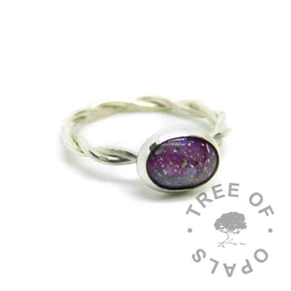 cremation ash ring with orchid purple and fairy pink resin sparkle mixes swirled together, no birthstone. Handmade twisted band EcoSilver ring shank, 10x8mm bezel cup. Watermarked copyright Tree of Opals memorial jewellery image