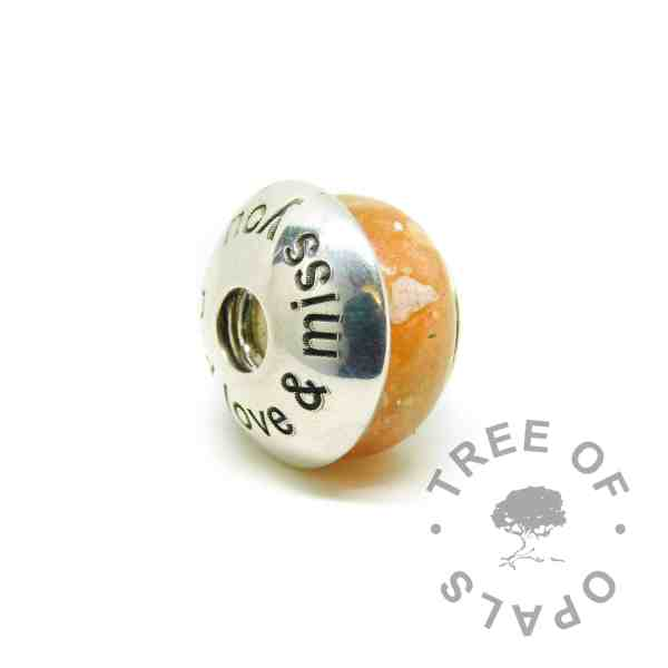 tangerine orange cremation ash charm shown with charm washer Arial font with Dad love & miss you. Sold separately