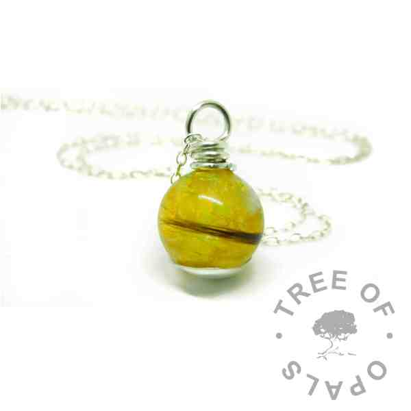 chimera yellow lock of hair pearl with smooth base and wire wrapped necklace setting