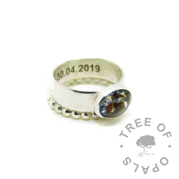 umbilical cord ring aegean blue resin sparkle mix and silver leaf, 6mm wide shiny engraved band, shown with bubble stacker