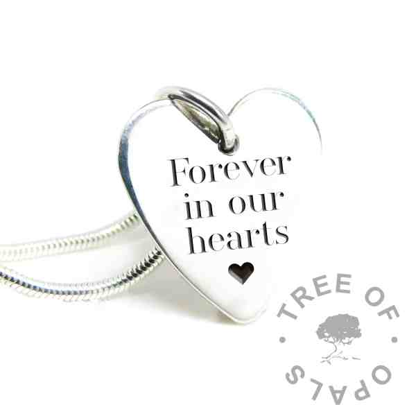 Forever in our hearts engraved large heart silver pendant. Silver South Serif font with heart emoji, laser engraved. Shown with a medium snake chain necklace and included jump ring. Mockup
