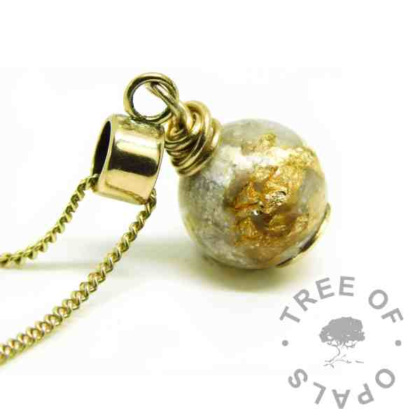 solid gold ashes pearl with 9ct gold European setting, shown on a medium-heavy 9ct yellow gold chain upgrade. Unicorn white resin sparkle mix and lots of gold leaf with cremation ashes in resin. Compatible with Chamilia and Pandora bracelets