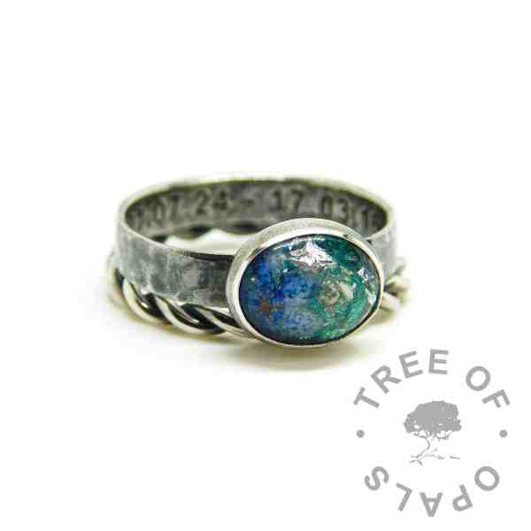 ashes jewellery patina rings with heavy antique effect, textured band engraved inside in Arial font, ashes with mermaid teal resin sparkle mix, siver leaf and a forget me not. Shown with a twisted wire stacking band