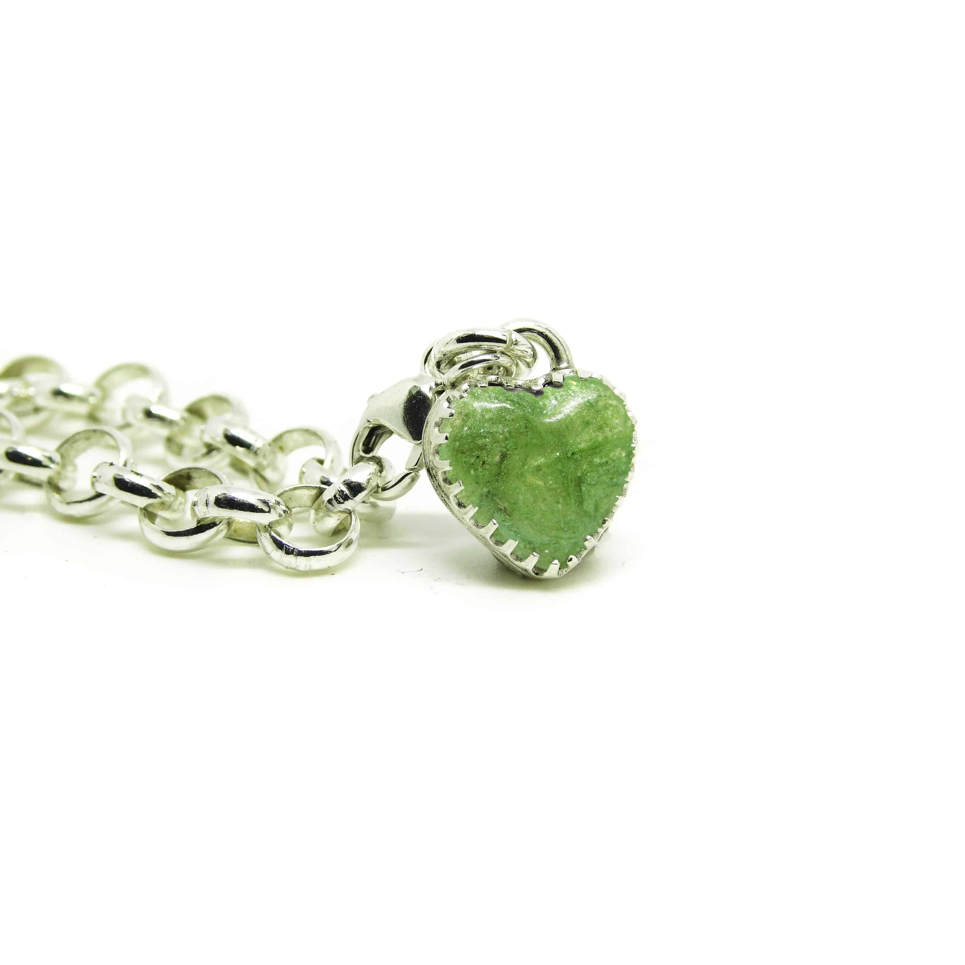 cremation ashes heart charm with basilisk green resin sparkle mix and new style scalloped edge heart. Lobster clasp for large link and Thomas Sabo bracelets