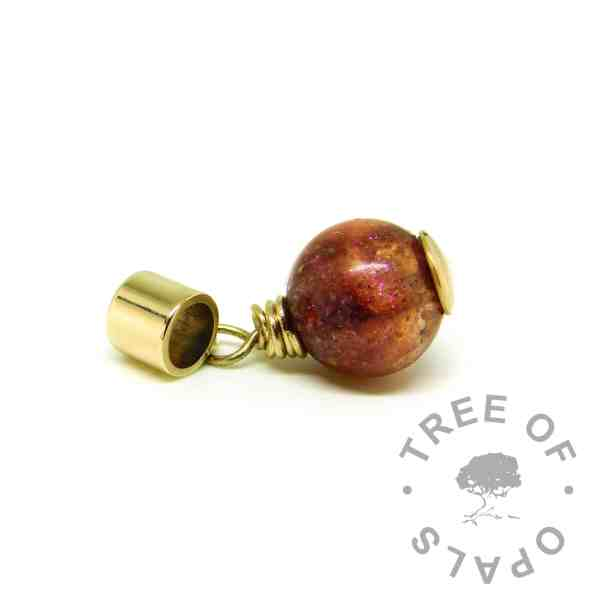 solid gold ashes charm, orb with solid 9ct gold wire wrapped setting for European bracelets like Pandora. Dragon's blood red resin sparkle mix