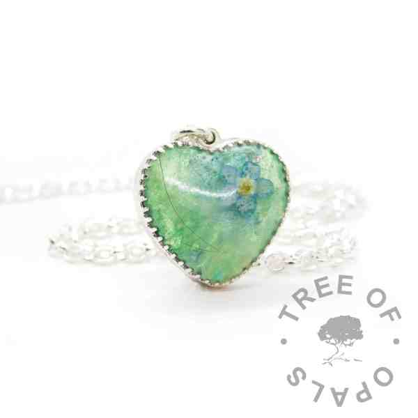 New style heart necklace setting with scalloped edge. Angelic aqua resin sparkle mix, mostly white hair, forget me not heart necklace, shown with a medium classic chain upgrade (mockup of new setting)