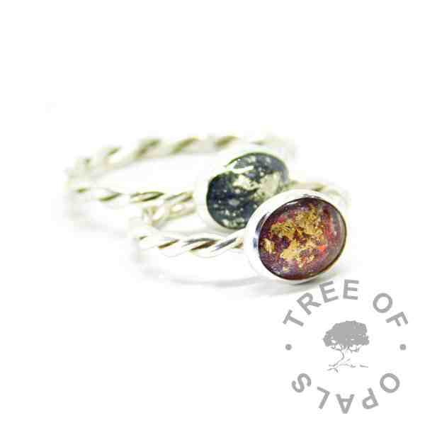 Ashes rings on twisted band with dragon's blood red resin sparkle mix and rose gold leaf, and vampire black resin sparkle mix with white gold leaf