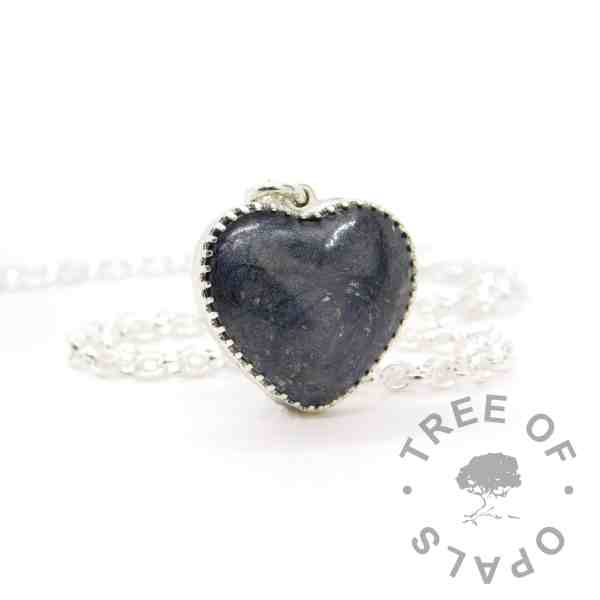 Cremation Ashes Heart Necklace New style heart necklace setting with scalloped edge. Vampire black resin sparkle mix, shown with a medium classic chain upgrade