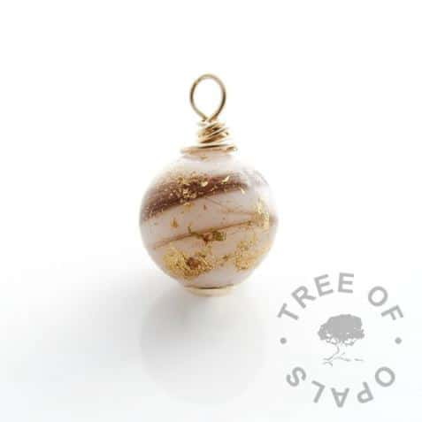 Solid yellow gold breastmilk orb with first curl and gold leaf, shown without chain or dangle charm setting. Golden boobies one year breastfeeding award