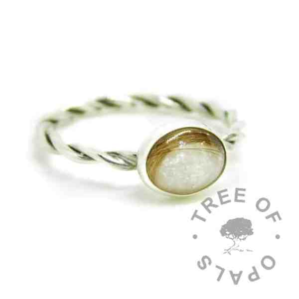 silver breastmilk ring, 10x8mm setting with hair and breastmilk, unicorn white resin sparkle mix. Twisted 2.4mm band, 935 anti-tarnish silver