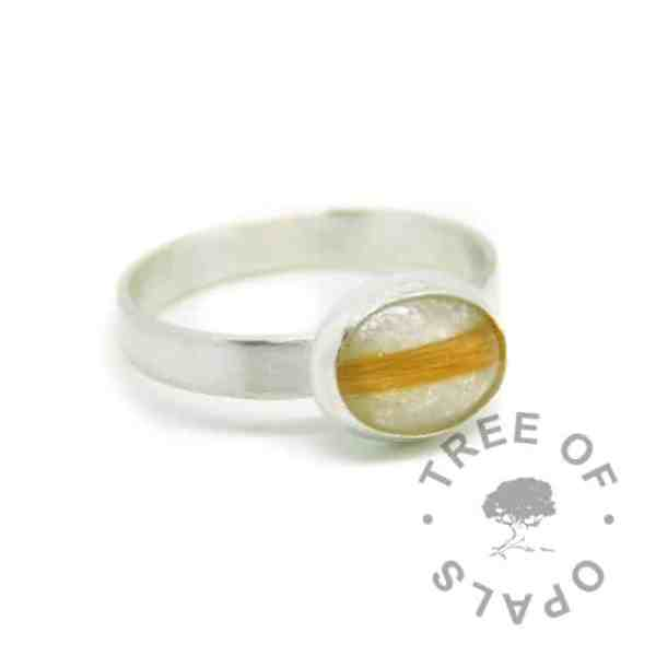 silver breastmilk ring, 10x8mm setting with hair and breastmilk, unicorn white resin sparkle mix. 3mm brushed band, 935 anti-tarnish silver