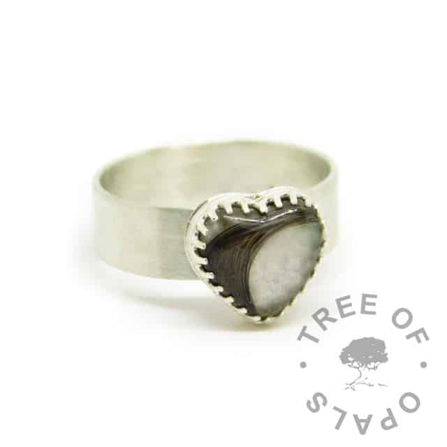 silver breastmilk heart ring, scalloped edge 10mm heart setting with hair and breastmilk. Brushed 6mm band, 935 anti-tarnish silver