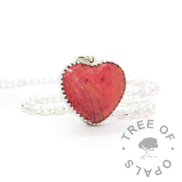 """New style heart necklace setting with scalloped edge. Dragon's blood red resin sparkle mix, lock of hair, shown with a medium classic chain upgrade (mockup of new setting). Remember that """"white hair"""" is often translucent in resin!"""