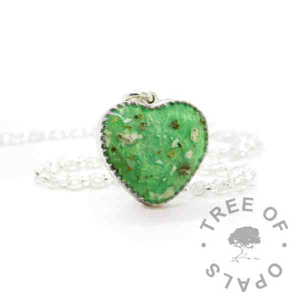 New style heart necklace setting with scalloped edge. Basilisk green resin sparkle mix, umbilical cord and silver leaf, shown with a medium classic chain upgrade (mockup of new setting)