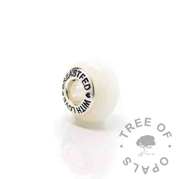 "classic breastmilk bead with ""breastfed with love"" core. No sparkle mix just preserved breastmilk and resin with solid sterling silver setting. Perfect for Pandora bracelets"