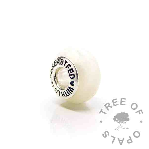 """pearly gold breastmilk bead with """"breastfed with love"""" core. Pearly gold breastmilk sparkle mix and preserved breastmilk and resin with solid sterling silver setting. Subtle warm pearly gold sparkle flashes at different angles with opalescent flakes. Perfect for Pandora bracelets"""