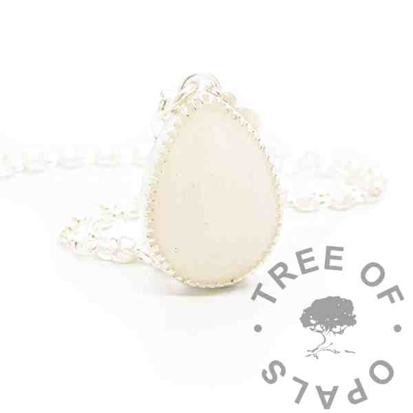 breastmilk teardrop necklace with diamond powder for two year breastfeeding award - diamond boobies. No colour or shimmer added, solid argentium silver 935 purity scalloped teardrop setting shown with chain