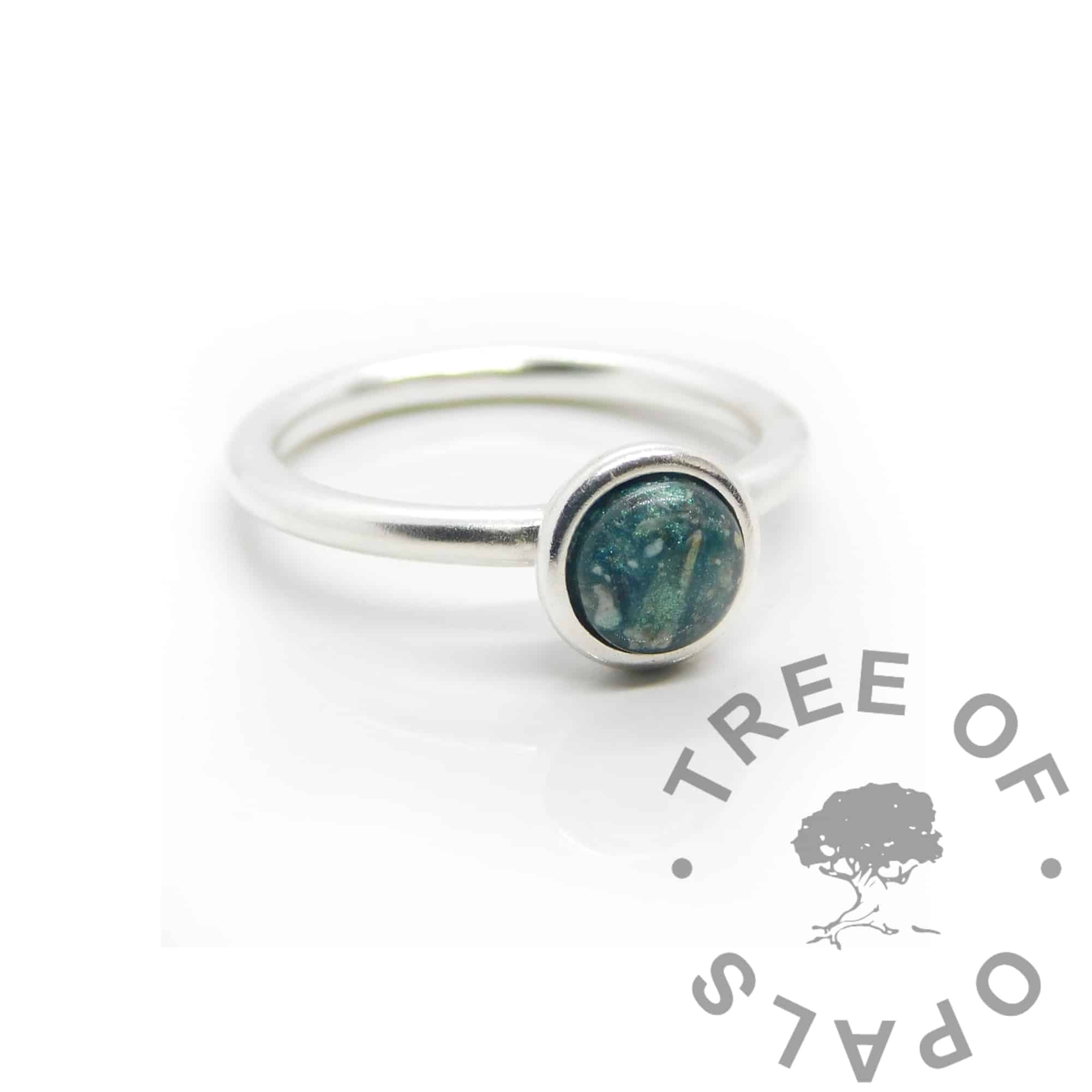 Ayla cremation ashes ring Teal ashes Ayla Solitaire Ring, cremation ashes and resin, with mermaid teal resin sparkle mix made into a cabochon (stone) and set into the ring with glue. Cast Argentium 935 anti-tarnish silver (higher purity than sterling)