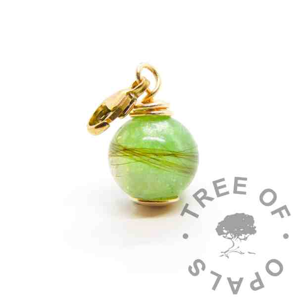 gold lock of hair dangle charm orb. Basilisk green resin sparkle mix, solid 9ct gold hand wire wrapped setting with lobster clasp dangle finding