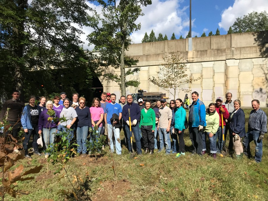 Volunteers who helped to plant 300 saplings in BonhAir Park where summer floods had toppled many mature trees along the banks of Four Mi8le Run. I-66 in background.