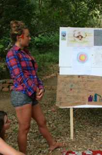 Christina looking on contemplatively during her groups Final Design Presentation