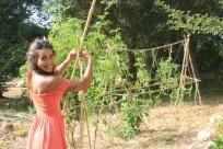 Dina creating garden climbing structures