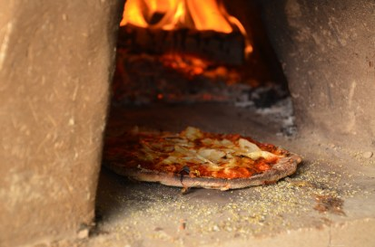 Pizza cooking the cob oven at the lake, authors family land in Kentucky, USA